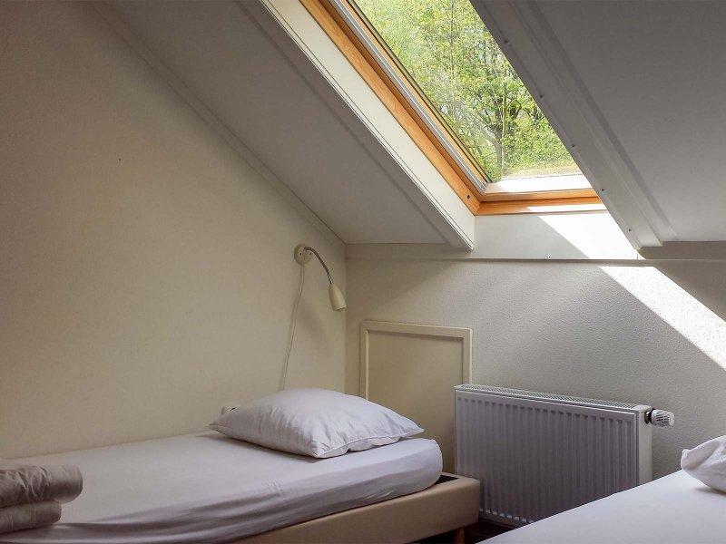 Een standaard slaapkamer in het Voorhuis op Meeuwenveen Accommodaties